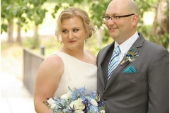 Alyssa-wedding-day-updo-with-peacock-hairpiece-and-blue-and-grey-toned-eye-and-red-lip-wedding-day-makeup