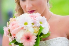 Brittany-bridals-with-braided-side-pony-hairstyle-and-smokey-eye-and-pink-toned-bridal-makeup