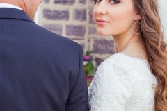Kelseys-down-and-loosely-curled-wedding-day-hair-and-lighter-smokey-eye-with-pinky-nude-lip-wedding-day-makeup