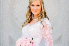 Kristens-half-up-with-loosely-curled-wedding-day-hair-and-brown-smokey-eye-and-pinky-nude-lip-wedding-day-makeup